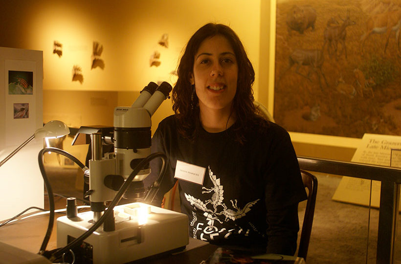 picture of Diana Marques at FossilFest demonstrating microscope techniques