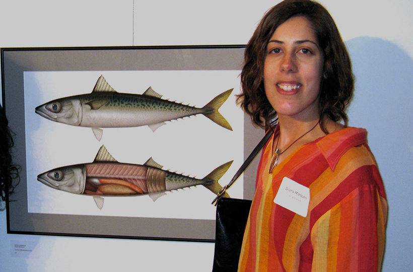 photo of Diana next to illustration of mackerels exhibit at the 14th Illustrators Club show