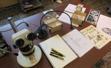 Table display for Fossil Day with microscope and tools